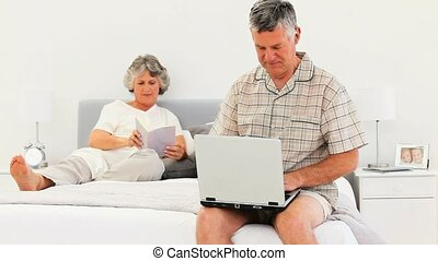 Elderly couple at the bed