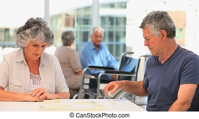 Couple playing dominos