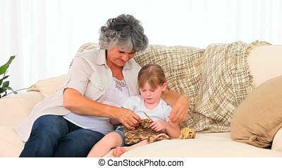 Grandmother knitting with her grand