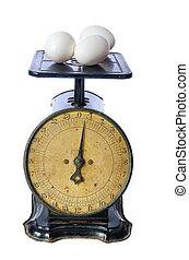 Eggs on an Old Scale - Eggs being weighed on an antique...