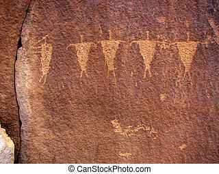 kokopelli and followers - petroglyph of kokopelli and four...