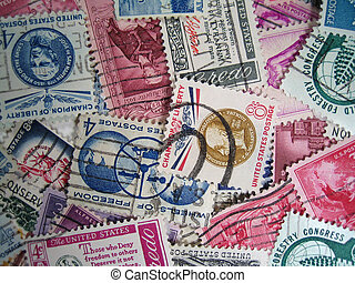 cancelled postage stamp background - a close up of cancelled...