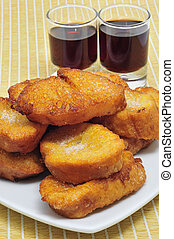 torrijas, typical Lent spanish sweet, and moscatel - a pile...