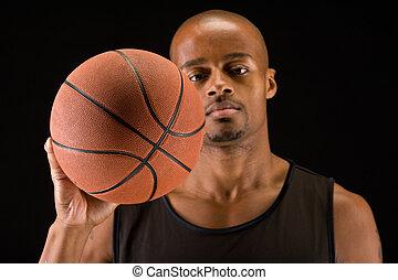 Basketball ball closeup - African american basketball player...