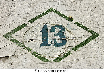 Number thirteen. Sign, put paint on the old wooden painted...