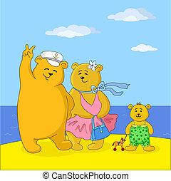 Teddy bears family on a beach