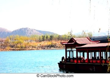 chinese river boat 3-4 - a old chinese boat traveling across...