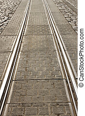 Detail of city tram track. Sunlight reflected on the rail