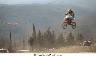 flying moto - motocross rider in the air