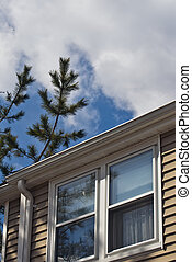 House Windows and Sky - The upper windows of a typical home...