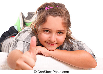 OK - Girl showing his thumb as a gesture of positivism