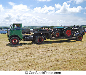 Old Articulated Lorry and Farm Tractor - An old english...