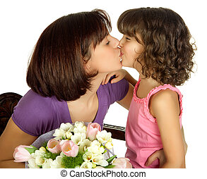 Mother kissing - Happy mother kissing her daughter on...