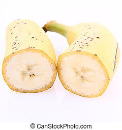Banana cut in half on white background