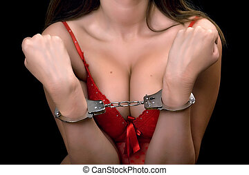 sexy woman in red lingerie handcuffed - Young sexy woman in...