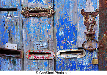 Old Mailboxes - Several old mailboxes in a n old wooden door...