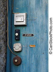 Old door bells - Old white door bells in a blue wooden door