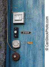 Old door bells - Old white door bells in a blue wooden door