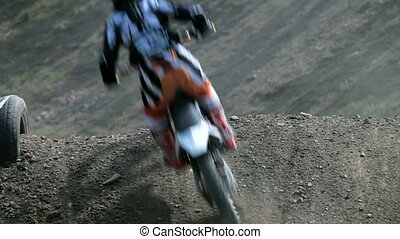 Motocross rider - bikers race in dry, dusty conditions