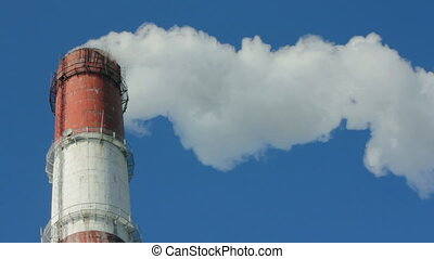 factory chimney with smoke under blue sky - timelapse