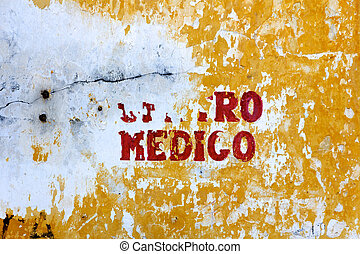 Centro Medico - a decayed, painted wall sign announcing a...