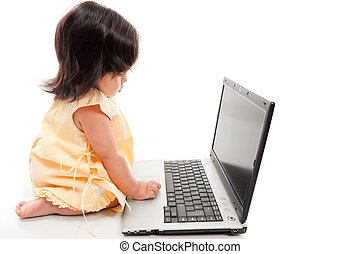 Child with technology - Asian child using an computer laptop...