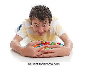 Boy hoarding easter eggs - A greedy or lucky boy hoarding...