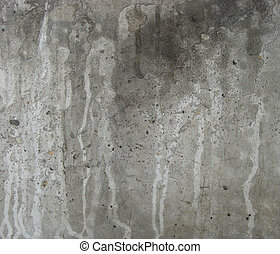 gray concrete wall with white drip leaks and dirt...