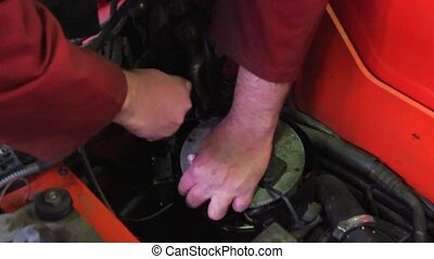 Mechanic removing part - Close up of the hands of a...