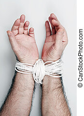 Hand tied with white rope