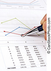 Financial report - Male hand writing on financial report