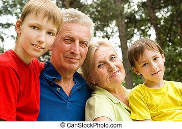 elderly couple with their grandchildren