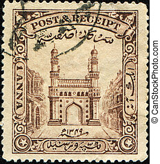 INDIA - CIRCA 1934: A stamp printed in Hyderabad shows...