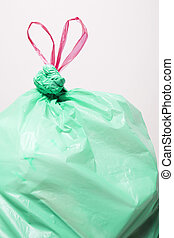 Green Plastic Bag - A green trash bag with red draw strings...