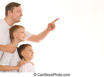 father with two sons standing