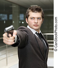 Business man with Gun - A bussiness man with a gun The focus...