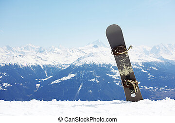 top of mountains in blue sky snowboard on it