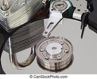 Harddrive Security - A strong lock reflected in a harddrive.