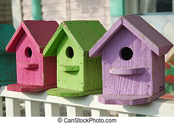 Colorful Birdhouses - Hand crafted birdhouses are painted...