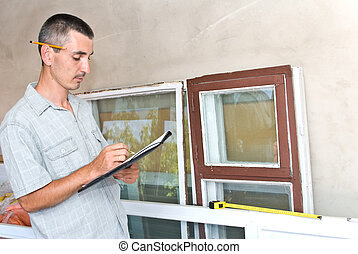 Man measures window