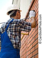 Man installing lamp