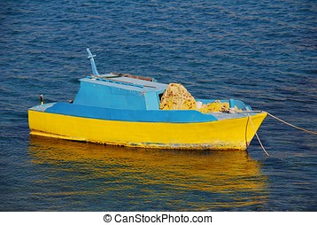 Fishing boat, Halki - A blue and yellow fishing boat moored...