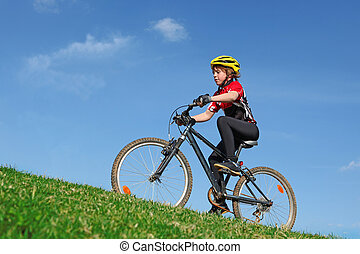 healthy fit child riding bike