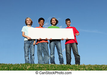 mixed race kids holding blank sign