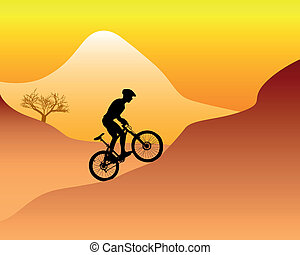mountain biker riding down hill - silhouette of a mountain...