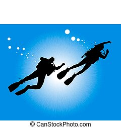 silhouettes of two divers swimming against the background of...