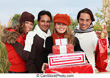 group of party goers with gifts
