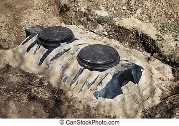Installation Of Septic Tank - A close up view of a newly...