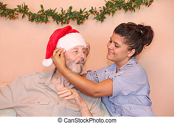 old man at christmas holiday time with carer