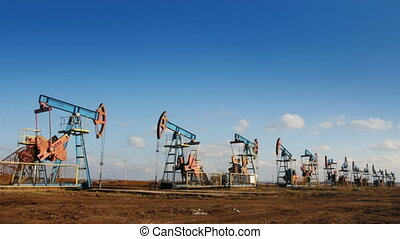 row of many working oil pumps